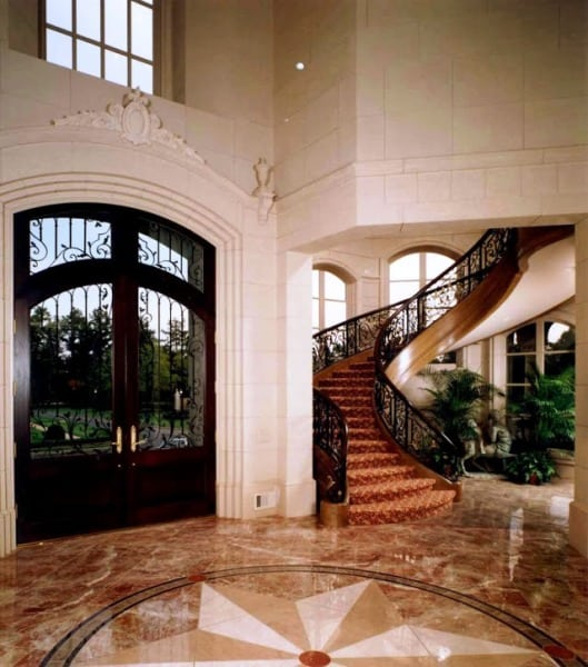 Curved Stairs with Wrought Iron Baluster