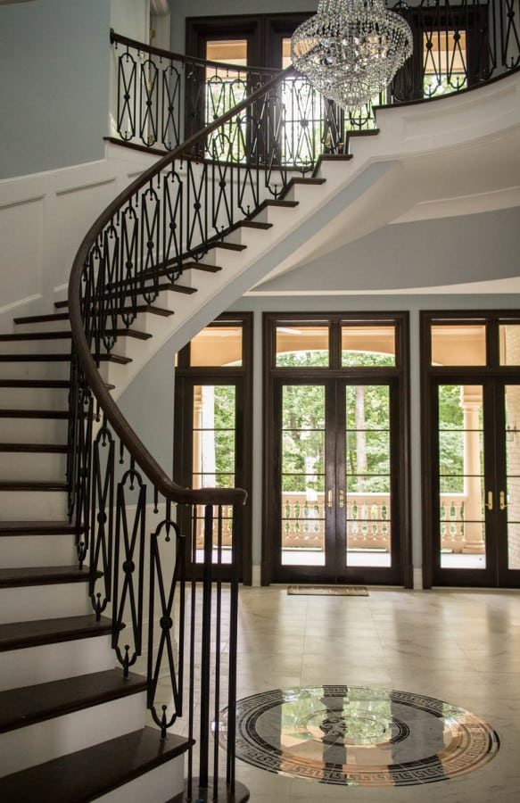 Beautiful Curved Stairs With Wrought Iron Handrail