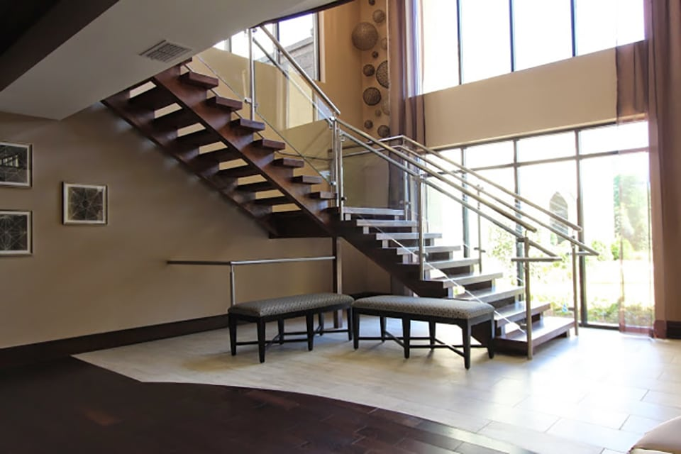 open riser stairs with glass handrail
