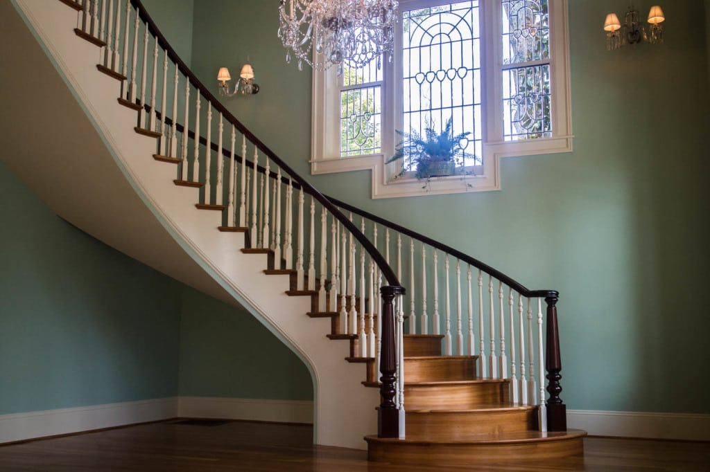 Double open curved staircase artistic stairs - Give home signature look elegant balustrades ...