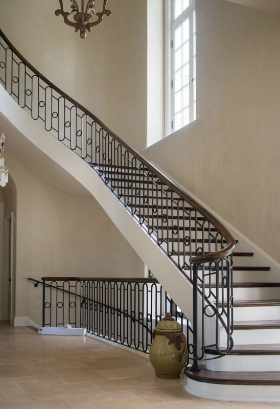 Curved stairs, wrought iron handrail