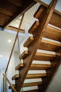 Open riser stair with cable rail