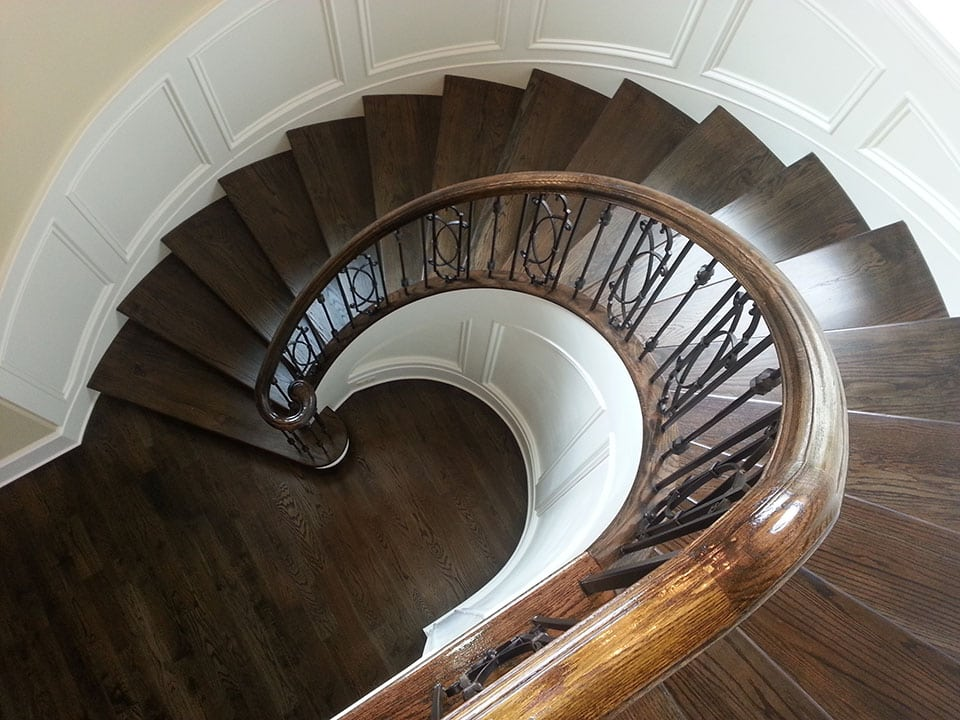 Stunning Round Stairs Using Wood Metal Balusters