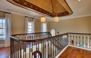 wrought iron railing and wooden baluster
