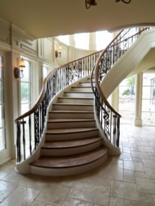 Tuscan style custom flared staircase