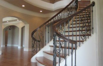 Curved Stairs with Wrought Iron Ballusters